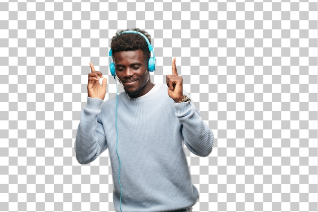 Young black man listening music with his headphones Premium Psd