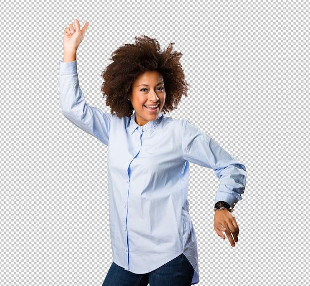 Young black woman dancing Premium Psd