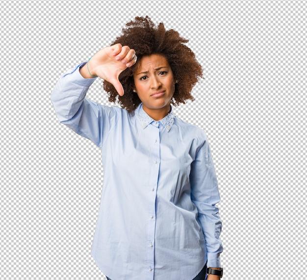 Young black woman doing a negative gesture Premium Psd
