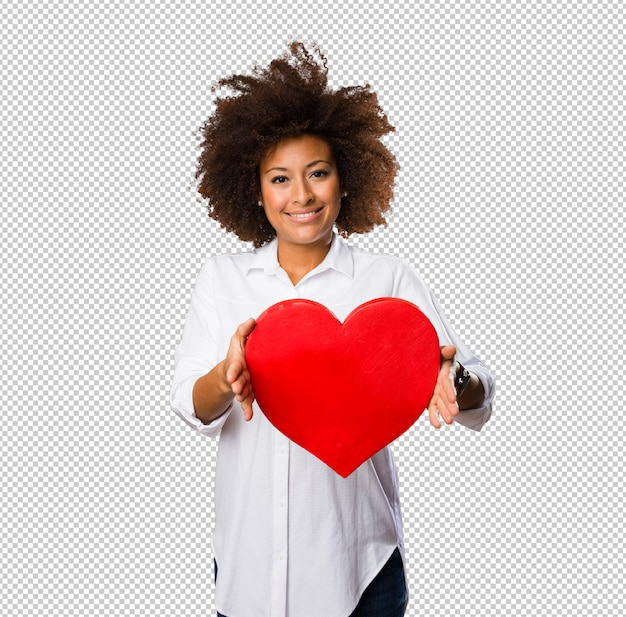 Young black woman holding a red heart shape Premium Psd