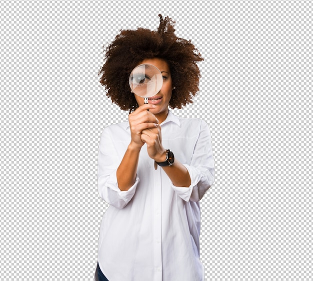 Young black woman looking through the magnifying glass Premium Psd