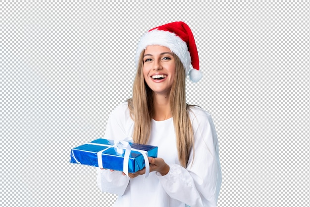 Young blonde woman holding a gift Premium Psd