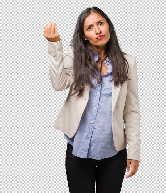 Young business indian woman doing a typical italian gesture, smiling and looking straight ahead, symbol or expression with hand Premium Psd