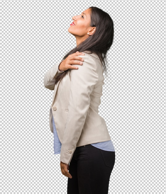 Young business indian woman with back pain due to work stress, tired and astute Premium Psd