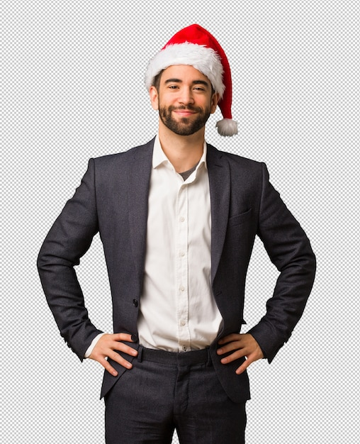 fc39df739a04c Young business man wearing santa hat with hands on hips PSD file ...