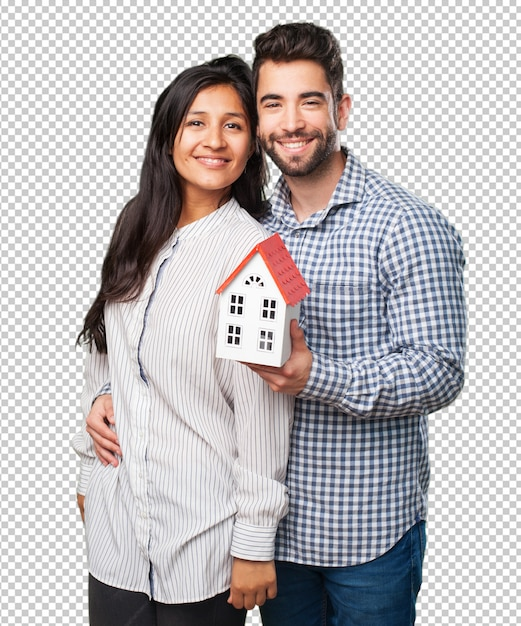 Young couple holding a house Premium Psd