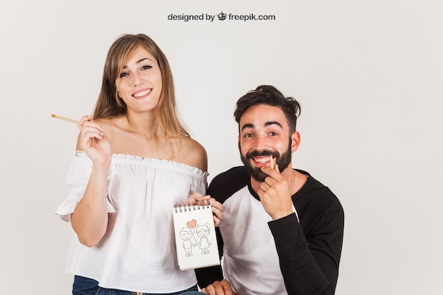 Young couple holding notepad Free Psd