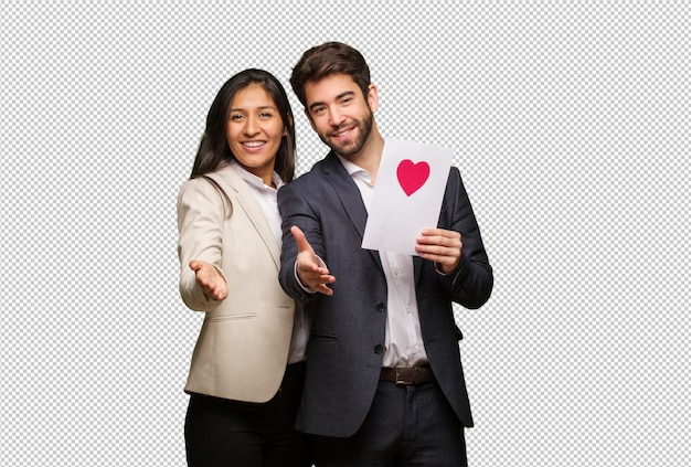 Young couple in valentines day reaching out to greet someone Premium Psd
