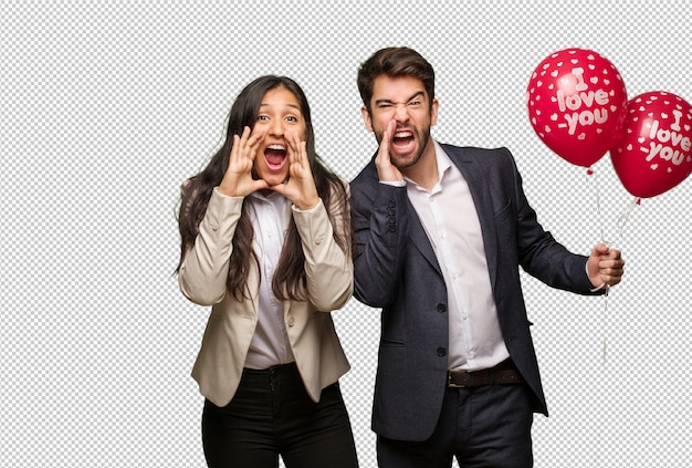 Young couple in valentines day shouting something happy to the front Premium Psd