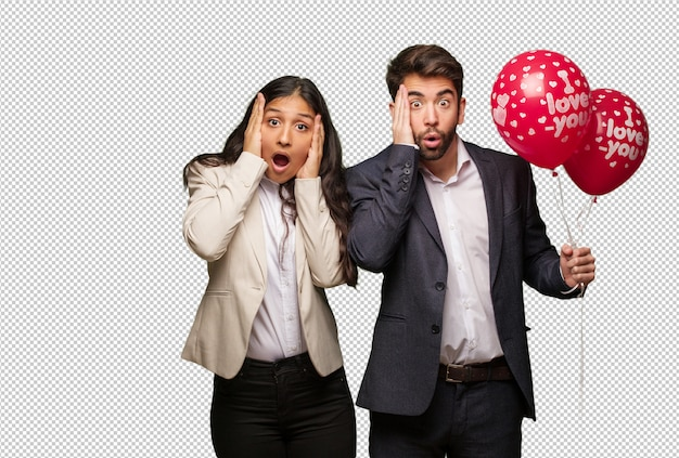 Young couple in valentines day surprised and shocked Premium Psd