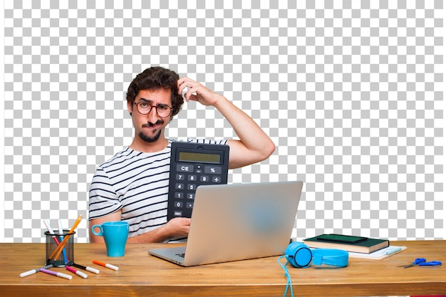 Young crazy graphic designer on a desk with a laptop and with a calculator Premium Psd