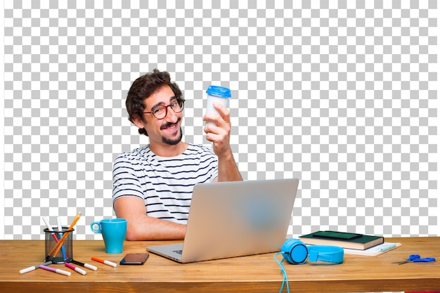 Young crazy graphic designer on a desk with a laptop and with a take away coffee Premium Psd