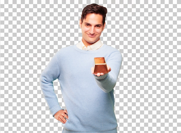 Young handsome tanned man with a gold ingot Premium Psd