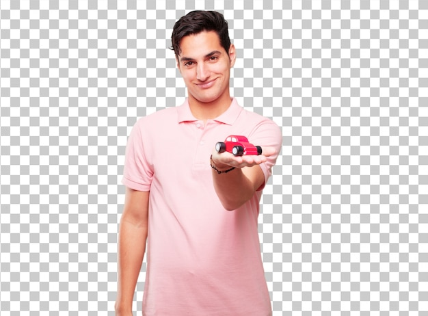 Young handsome tanned man with a red car model Premium Psd