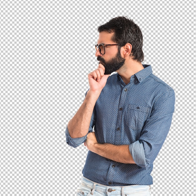 Young hipster man thinking over white background Premium Psd