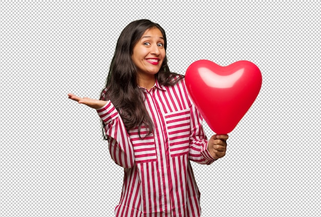 Young indian woman celebrating valentines day Premium Psd