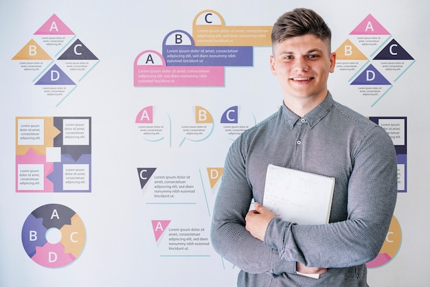 Young male at university holding book Free Psd