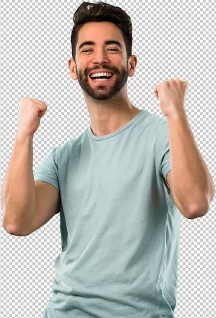 Young man celebrating a success Premium Psd