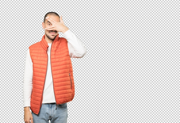 Young man covering his eyes with his hands Premium Psd