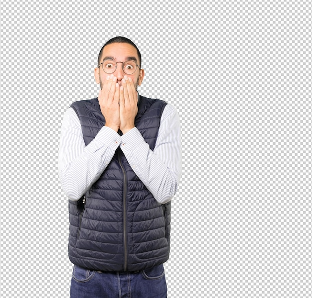 Young man covering his mouth with his hands Premium Psd