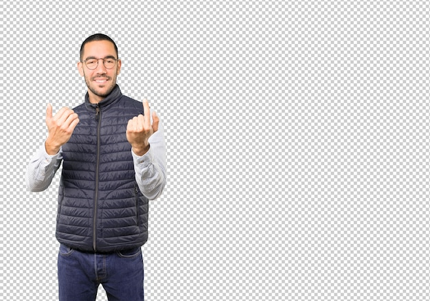 Young man doing a gesture of come here Premium Psd
