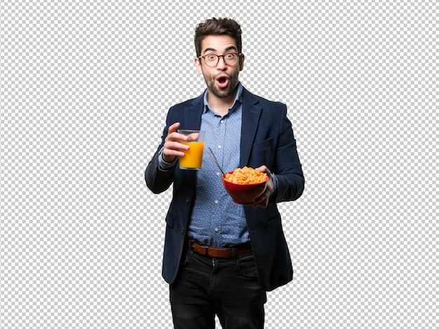 Young man getting breakfast Premium Psd