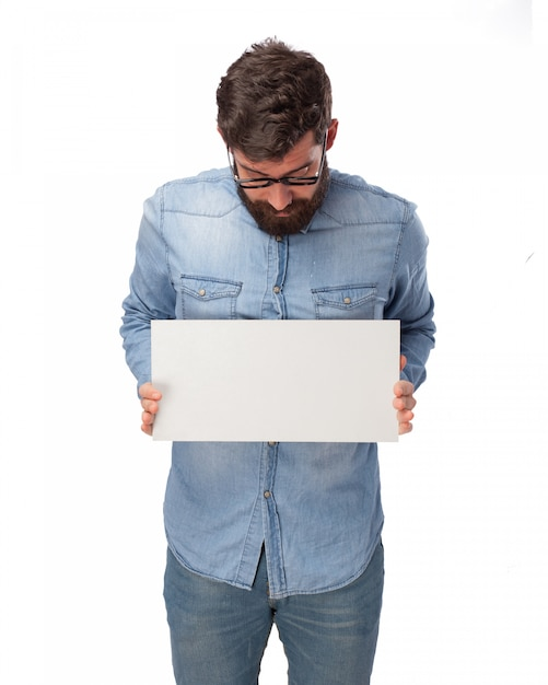 Young Man Holding A Blank Poster PSD File