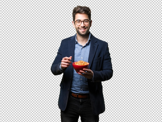 Young man holding a bowl of corn flakes Premium Psd