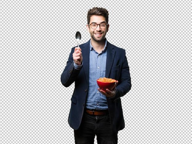 Young man holding corn flakes bowl Premium Psd