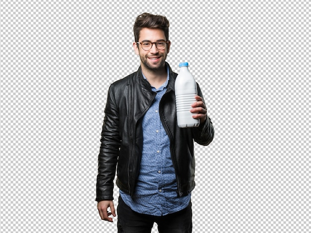 Young man holding a milk bottle Premium Psd
