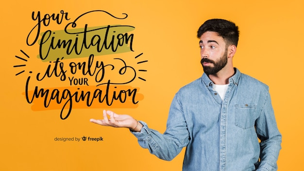 Young man holding a motivational quote Free Psd