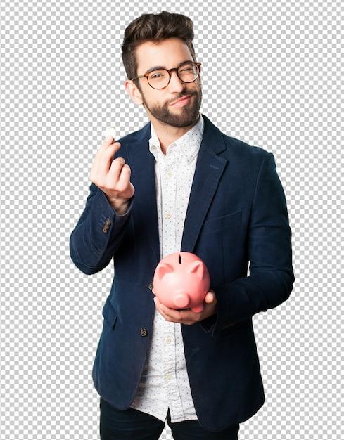 Young man holding a piggy bank Premium Psd