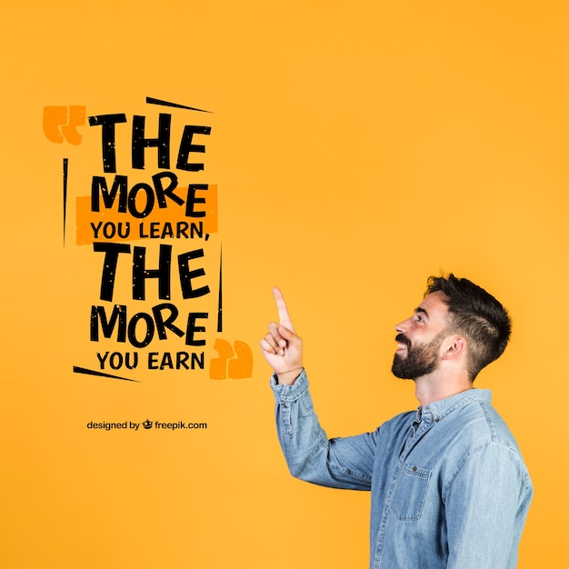 Young man pointing finger to a motivational quote Free Psd