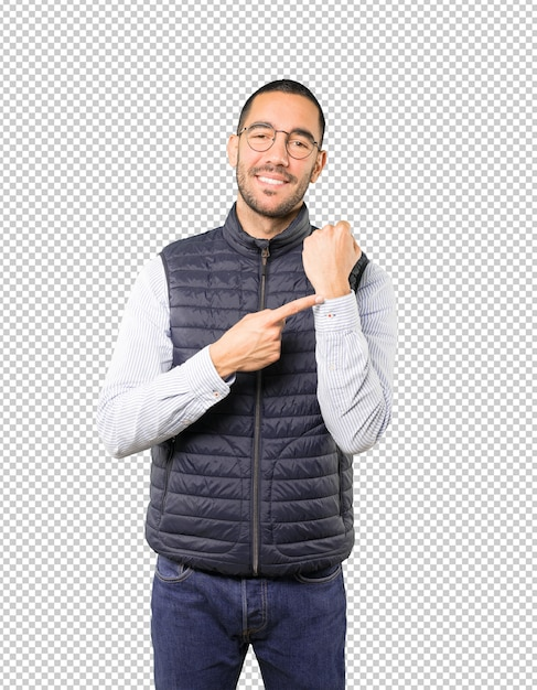 Young man pointing to his wrist Premium Psd