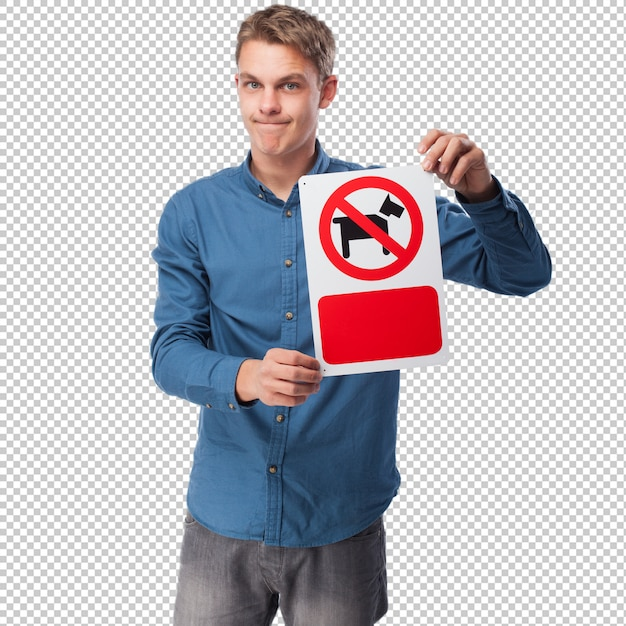 Young man showing a restricted are for dogs sign Premium Psd