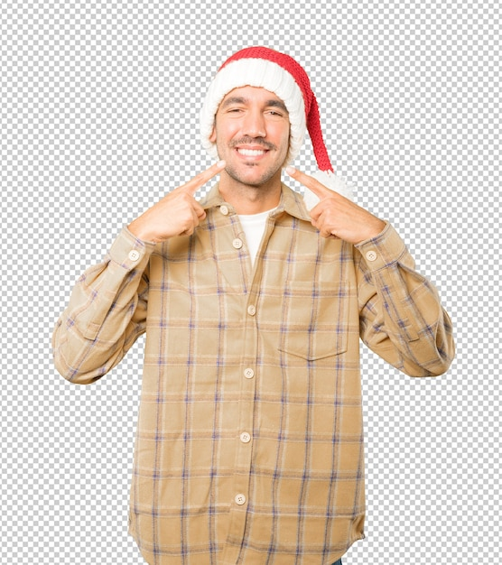 Young man wearing a christmas hat while gesturing isolated Premium Psd