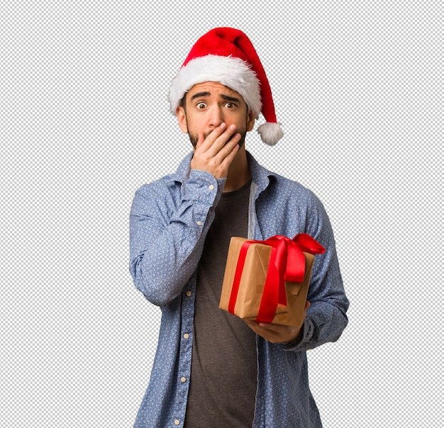 e836b8a56a2b4 Young man wearing santa hat very scared and afraid hidden PSD file ...