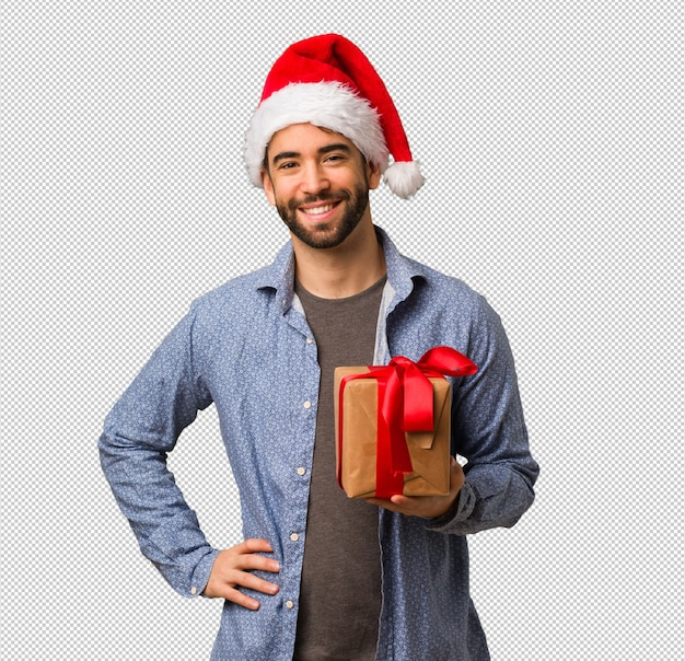 fba512c38463c Young man wearing santa hat with hands on hips Premium Psd