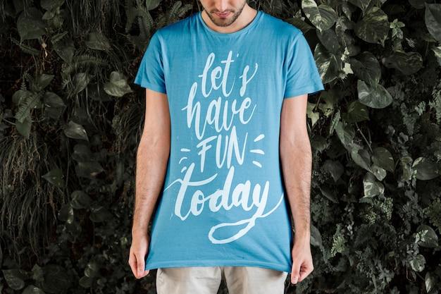 Young man wearing t shirt mockup Free Psd