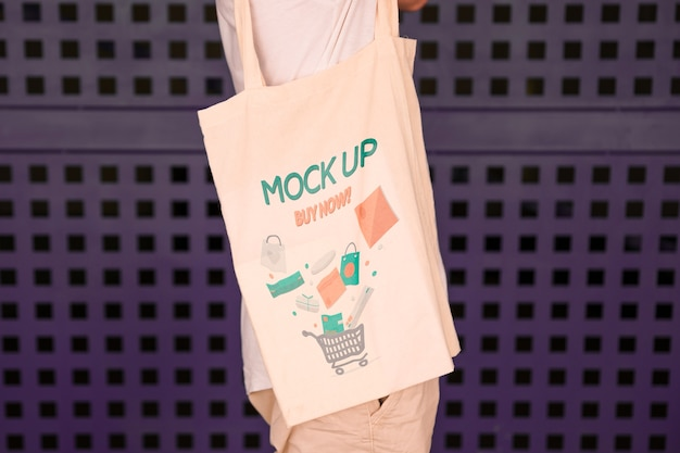 335a7770 Young man with bag mockup PSD file | Free Download