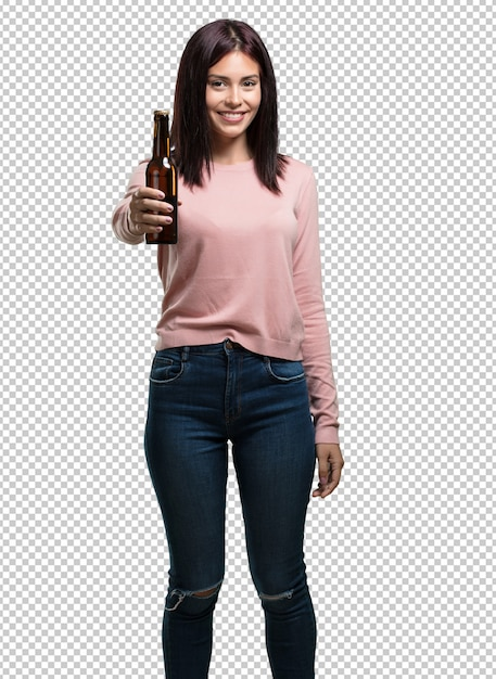 Young pretty woman happy and fun, holding a bottle of beer, feels good after an intense day of work, ready to watch a soccer match on television Premium Psd