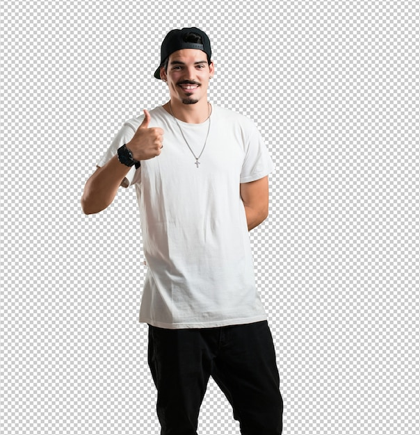 Young rapper man cheerful and excited, smiling and raising her thumb up,  success and approval, ok gesture Premium Psd