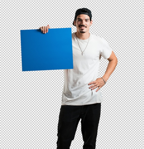 Young rapper man cheerful and motivated, showing an empty poster where you can show a mess Premium Psd