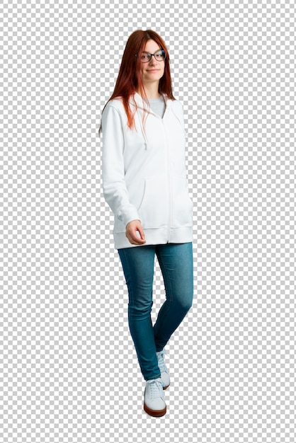Young redhead girl in an urban white sweatshirt with glasses walking. motion gesture. Premium Psd
