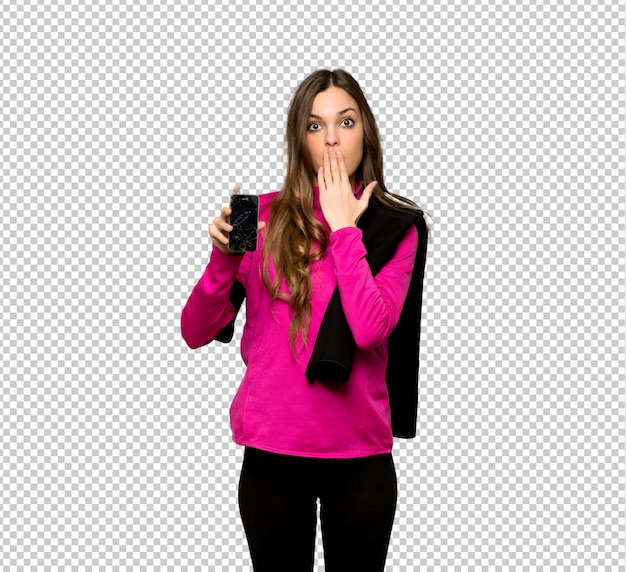 Young sport woman with troubled holding broken smartphone Premium Psd