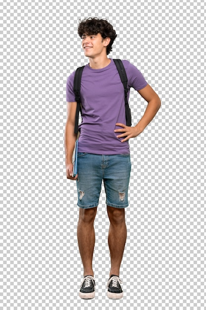 Young student man posing with arms at hip and smiling Premium Psd