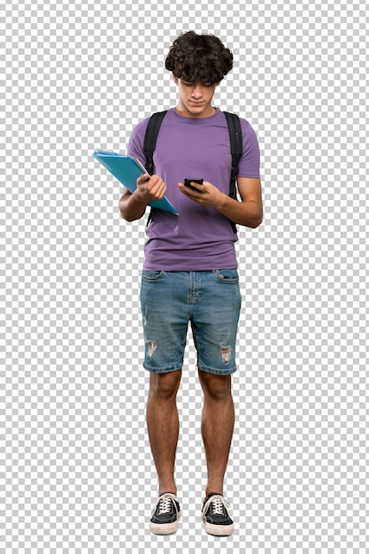 Young student man sending a message with the mobile Premium Psd