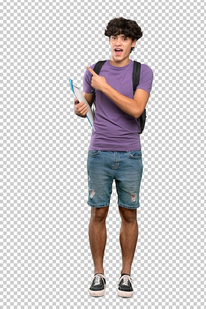 Young student man surprised and pointing side Premium Psd