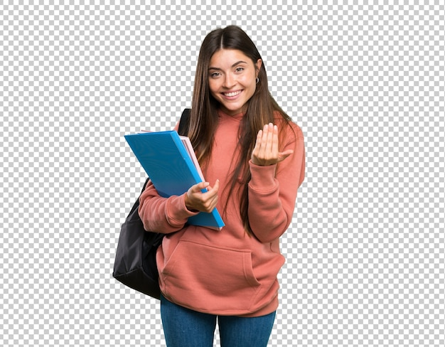 Young student woman holding notebooks inviting to come with hand. happy that you came Premium Psd
