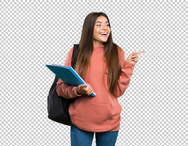 Young student woman holding notebooks pointing finger to the side Premium Psd